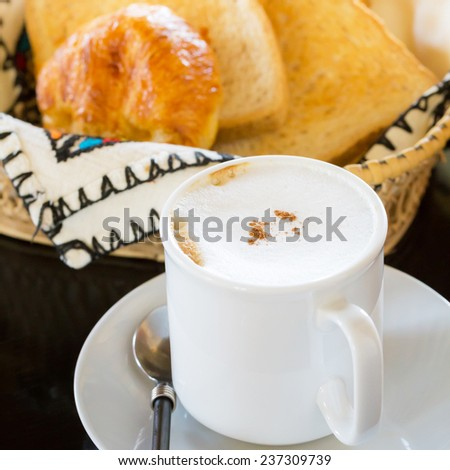 Hot Coffee with Bread in background : Selective Focus - stock photo