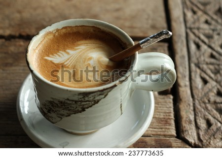 Hot coffee with cinnamon stick - stock photo