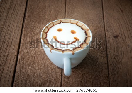 Hot coffee with cream decorate smile shape on top - stock photo