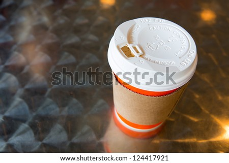 Hot coffee with cup holder - stock photo