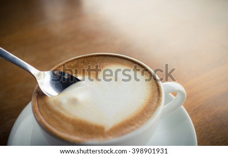hot coffee with foam milk art of love(vintage effect) - stock photo