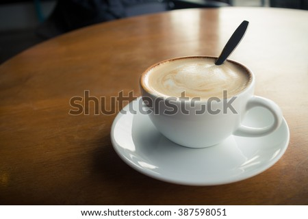 hot coffee with foam milk(vintage effect) - stock photo