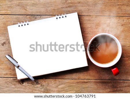 Hot coffee with note on wood background - stock photo