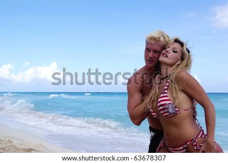Hot couple summer fun day beach - stock photo