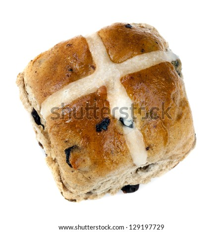 Hot cross bun, isolated on white background.  Delicious Easter treat. - stock photo