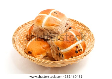 Hot Cross buns in the basket isolated on white background  - stock photo