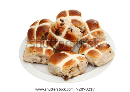 Hot cross buns on a plate isolated against white - stock photo