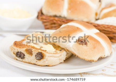 Hot Cross Buns -  Spiced sweet buns with raisins. Traditional Easter meal. - stock photo