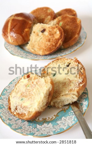 Hot cross buns toasted and buttered, a traditional Easter treat
