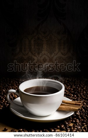 hot cup of coffee, bean and aromatic cinnamon - stock photo