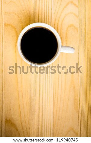Hot Cup of Coffee on a Wooden Table - stock photo