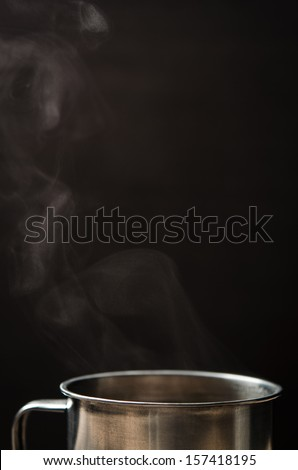 hot cup of coffee on black background