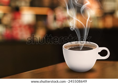 Hot Cup of Coffee On Wood Table - stock photo