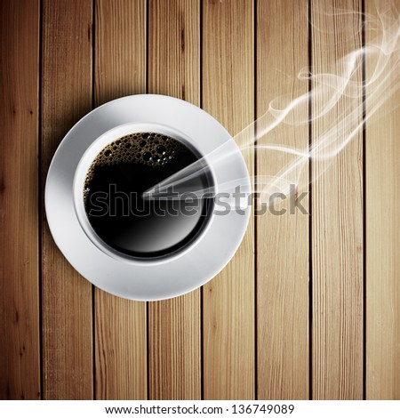 Hot cup of coffee on wood table and smoke coming out - stock photo