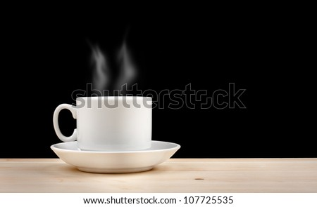 Hot Cup of Coffee or Tea on Wooden Table on Black Background - stock photo