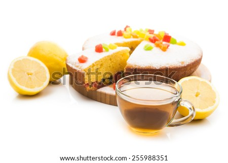 Hot cup of tea. Tasty pie with lemons isolated on white background. - stock photo