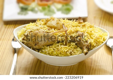 Hot delicious chicken biryani with salad and rita - stock photo