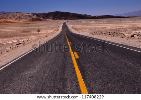 Hot Desert Road in Death Valley National Park, California - stock photo