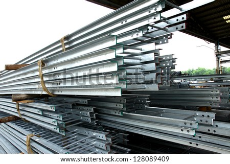Hot-dip Steel Ladder bunch in warehouse before shipment - stock photo