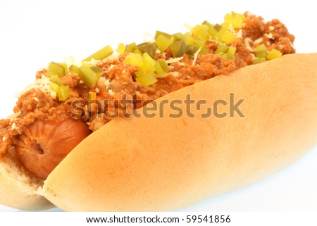 hot dog against white background with chili , onions and pickles on top - stock photo