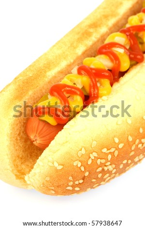 hot dog against white background with onions and pickles on top