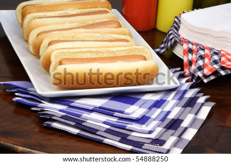 hot dog ingredients on a nice table setting rich in colors and flavors - stock photo
