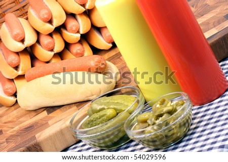 hot dog ingredients on a nice table setting rich in colors and flavors perfect for pick nicks (focus on hot dog) - stock photo