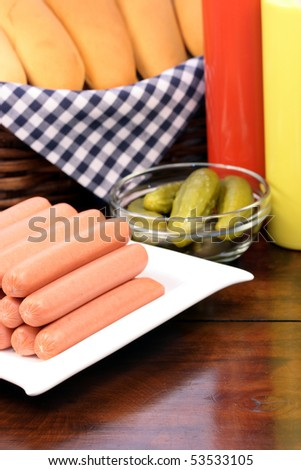 hot dog ingredients on a nice table setting rich in colors and flavors perfect for picnickers - stock photo