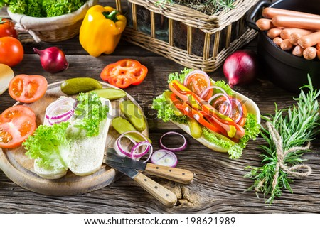 Hot dog made with fresh ingredients - stock photo
