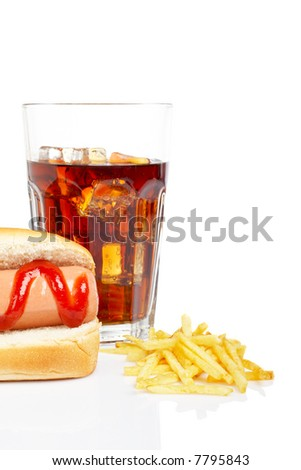 Hot dog, soda glass and french fries, reflected on white background. Shallow DOF - stock photo