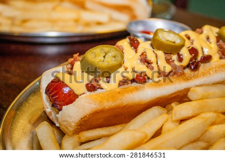 Hot dog with cheese and hot spice