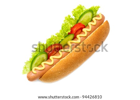 hot dog with cucumbers, tomatoes, lettuce, and mustard on top isolated on white