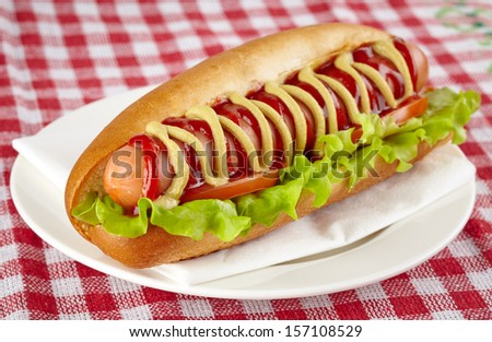 Hot dog with lettuce and tomato - stock photo