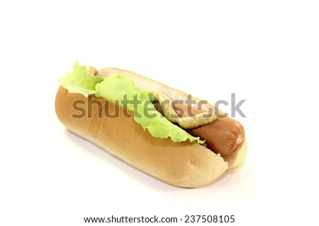 Hot dog with lettuce leaf, sausage and mustard - stock photo