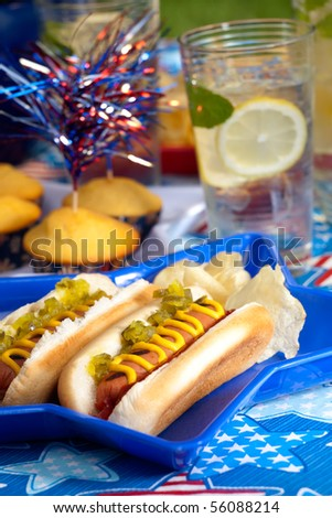 Hot dogs and cornbread on 4th of July in patriotic theme - stock photo