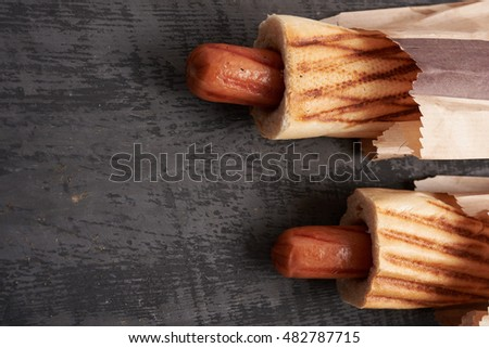 hot dogs lying on the wooden table