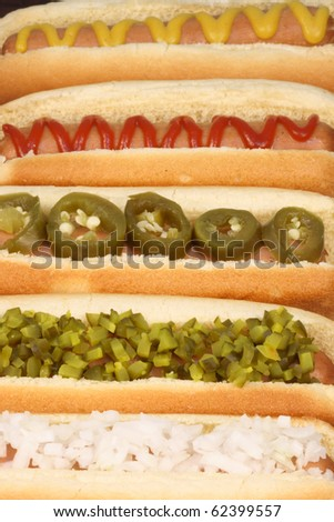 hot dogs on a nice table setting rich textures colors and flavors - stock photo
