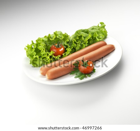 Hot dogs on a plate - stock photo