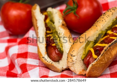 Hot dogs picnic lunch with tomatoes