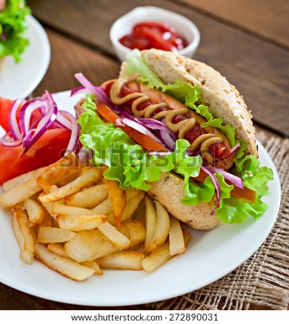 Hot Dogs - sandwich with French fries on white plate, close-up. - stock photo