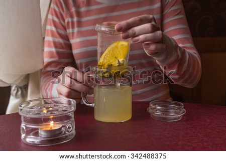 Hot drink from a sea-buckthorn in a glass cup - stock photo
