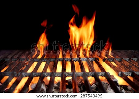 hot empty charcoal bbq grill with bright flames on the black background cookout concept