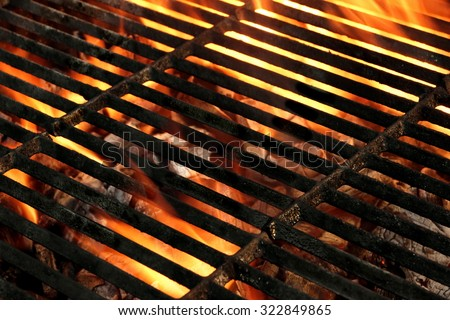 Hot Empty Flaming BBQ Grill Background Texture. Cookout Concept - stock photo