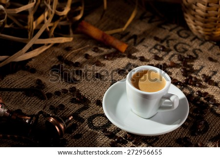 Hot Espresso Cup with Coffee Beans - stock photo