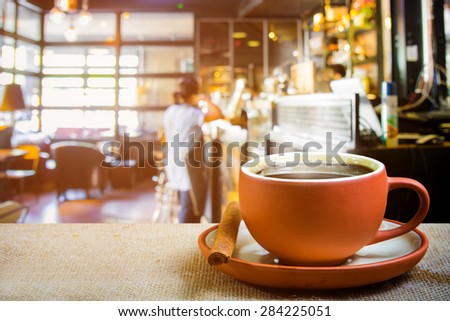 Hot espresso on the table with blur coffee shop background  - stock photo