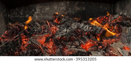 Hot fiery burning coals - stock photo