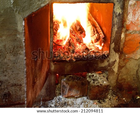hot fire in furnace with open door close up - stock photo