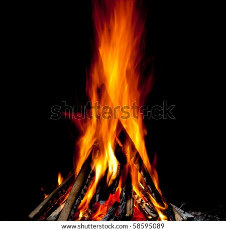 Hot fireplace full of fire wood - stock photo
