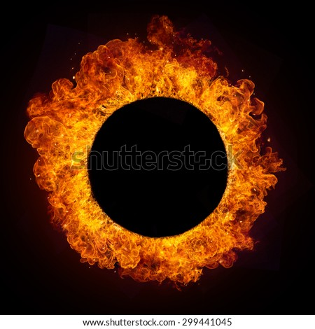 Hot fires flames in rounded shape, isolated on black background. Free copyspace in centre - stock photo