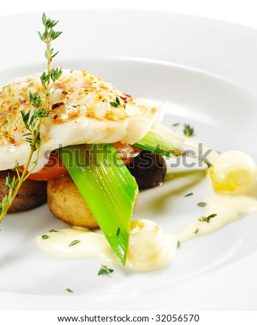 Hot Fish Dishes - Halibut fillet with Mushrooms, Tomatoes and Bacon - stock photo